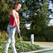 Young woman playing golf in a country club — Stock Photo #9117951