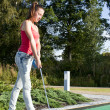 Stock Photo: Young womplaying golf in country club