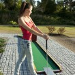 Young woman playing golf in a country club — Stock Photo #9117973