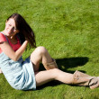 Beautiful healthy Young Woman lying on the green grass — Stock Photo #9118631