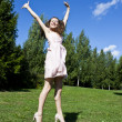 Beautiful young happy woman under blue sky. — Стоковое фото