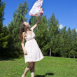 Stock Photo: Beautiful young womdancing with kerchief against blue sky