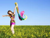 Beautiful young girl on the field — Stock Photo