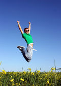 Young men jump in the meadow — Stock Photo