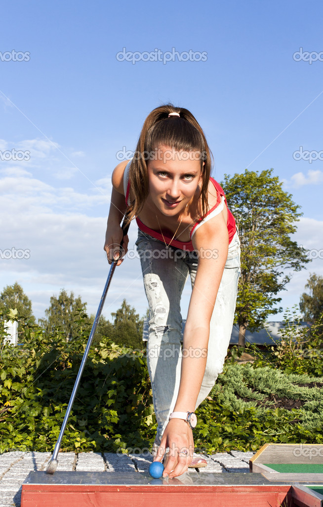 Young beautiful girl plays golf on a sunny day, summer — Stock Photo #9117963