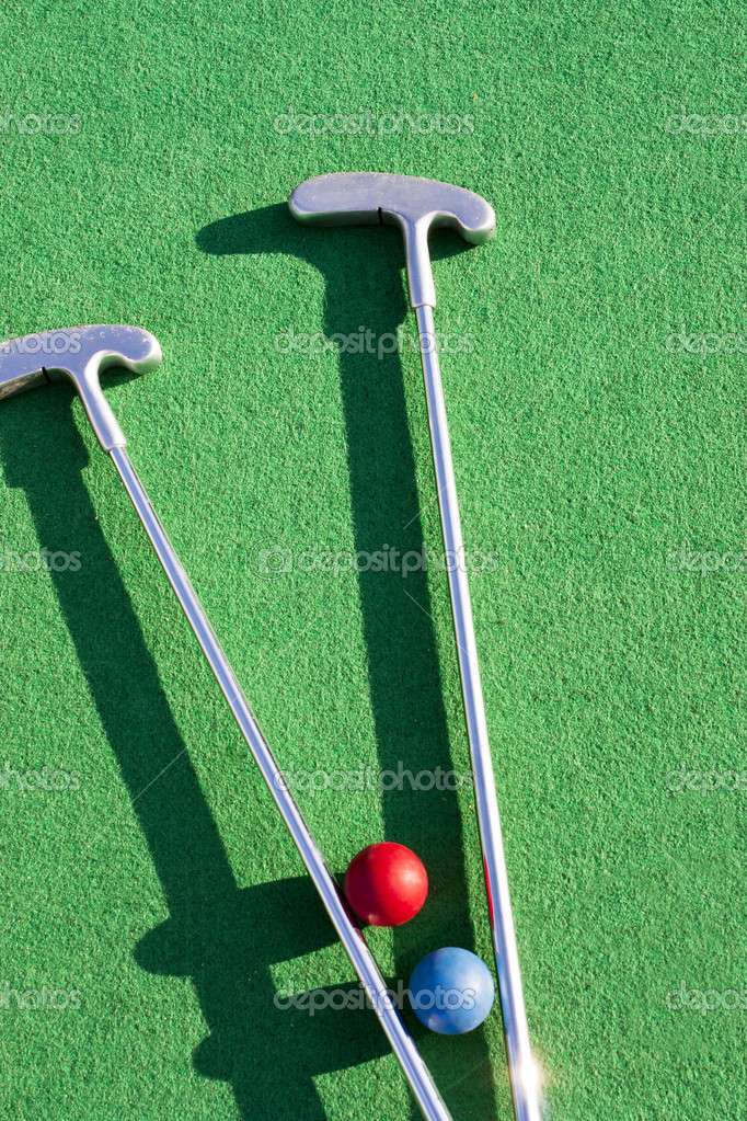 Set of mini golf clubs and color balls on green covering — Stock Photo #9118017
