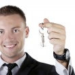 Young businessman holding a key — Stock Photo #9121963