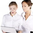 Two beautiful businesswoman working on the laptop — Stock Photo #9123260