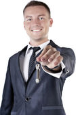 Business man giving you the keys to a home — Stock Photo
