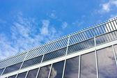 Modern office house. blue glass on a background sky — Stock Photo