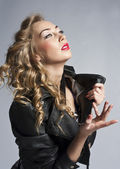 Beautiful slim sexy blond, girl in leather jacket — Stock Photo