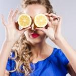 Beautiful blond with lemon — Stock Photo #9376430