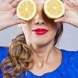 Portrait of woman, holding fresh lemon — Stock Photo