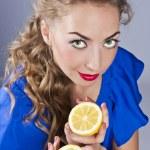 Beautiful blond with lemon — Stock Photo #9449169