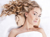 Beautiful young woman with long curly hair — Stock Photo
