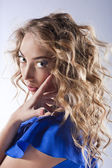 Curly blonde with bright makeup — Stock Photo