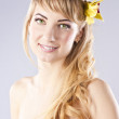 Young beautiful woman with yellow flower — Stock Photo #9734301