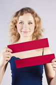 Fun woman holding a banner — Stock Photo