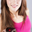 Beautiful brunette woman with a cake — Stock Photo