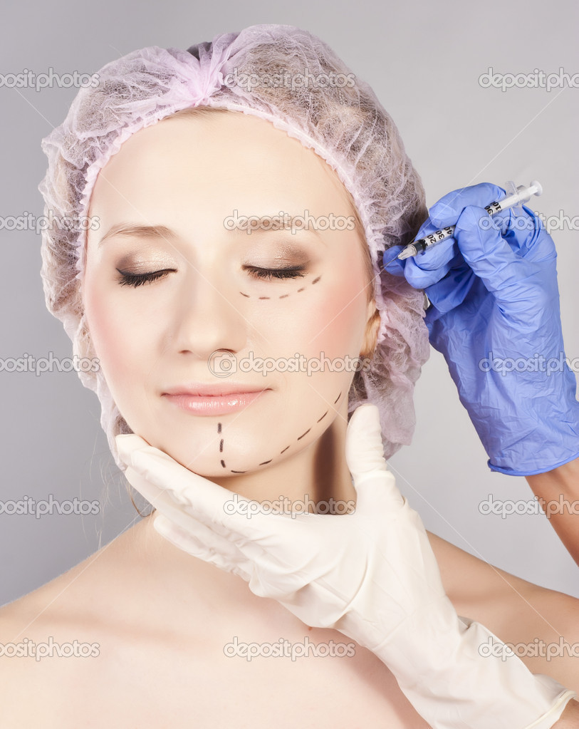 Drawn lines on woman's face, marks for facial plastic surgery — Stock Photo #9874160