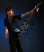 Brutal man with electric guitar — Stock Photo