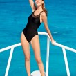 Young woman in swimsuit posing on yacht - ストック写真