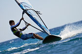 Side view of young windsurfer — Stock Photo