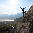 Female rock climber with outstretched arms — Stock Photo