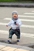 Little boy crossing a street — Stock Photo
