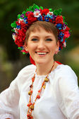 Young woman in traditional Ukrainian costume — Stock Photo