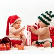 Two cute babies in Christmas costumes — Stock Photo #8083983