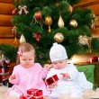 Royalty-Free Stock Photo: Two baby girls playing with Christmas gifts