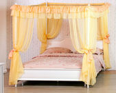 Luxurious canopy bed — Stock Photo