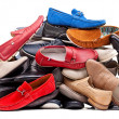 Foto Stock: Pile of various men shoes, with clipping path