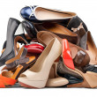 Pile of various female shoes, with clipping path — Stock fotografie
