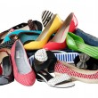 Stock Photo: Pile of various female summer shoes, with path