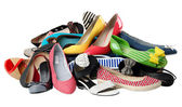 Pile of various female summer shoes, with path — Stock Photo