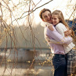 Stock Photo: Young couple having fun outdoors in early spring
