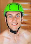 Cheerful young man in sports protective helmet — Stock Photo