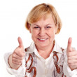Happy mature woman showing thumbs up sign — Stock Photo