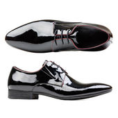 Black patent leather men shoes against white — Stock Photo