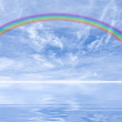 Rainbow and clouds — Stock Photo