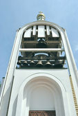 White bell tower is against blue sky — Stock Photo