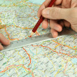 Determination of course on touristic map — Stockfoto #9199730