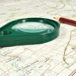 The chart of country, magnifying glass and red pencil — Stock Photo