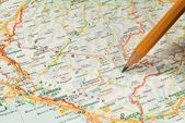 The touristic map and pencil — Stock Photo