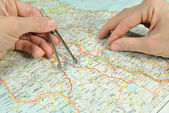 The measuring of distance by dividers on the map. — Stock Photo