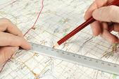 La determinación por supuesto en el mapa turístico — Foto de Stock