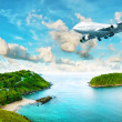 Jet plane over the tropical island — Stock Photo #10411905