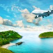 Stock Photo: Jet plane over tropical island